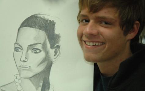 AP Art student Tristan Thompson, a senior, focuses his theme portfolio on people. His portrait art displays the detailed features of his images. AP Art students present their portfolios in May.