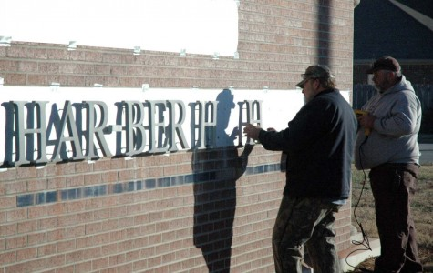 Aluminum letters added to sign