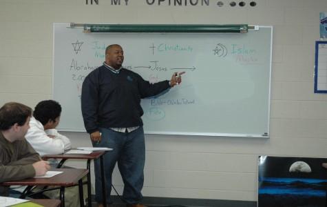 Former teacher sues school, district