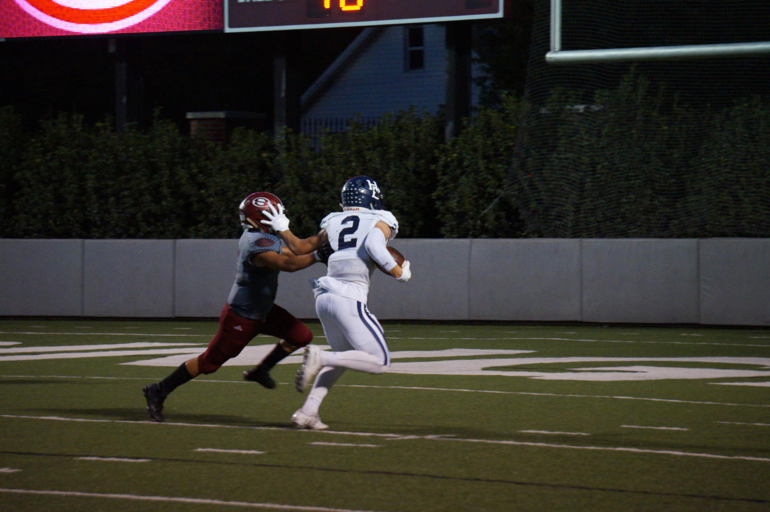 Junior receiver Hunter Wood stiff arms a Bulldog defender to score a touchdown Oct. 5.