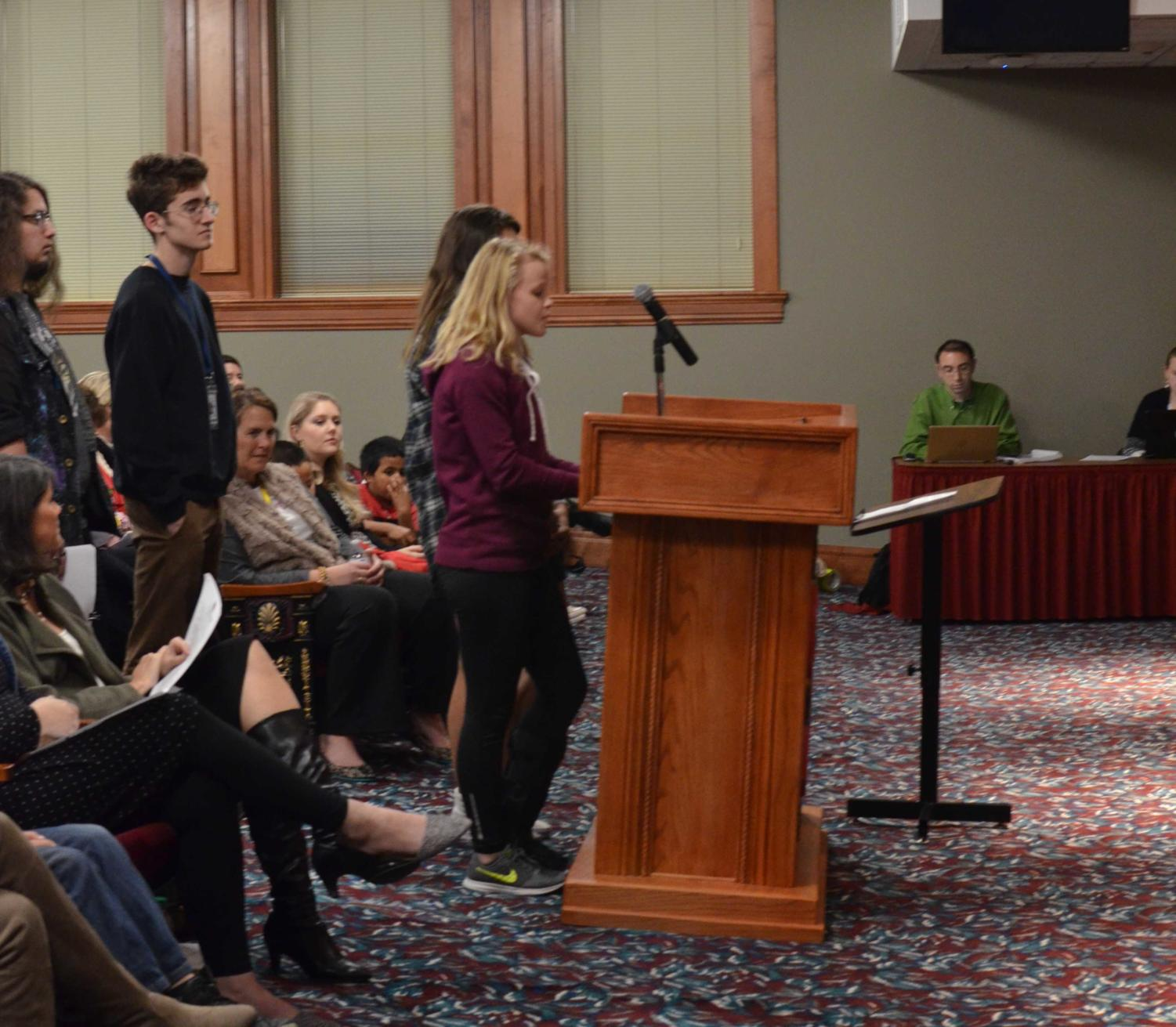 Students from the Wildcat yearbook and The Herald staff speak to the Springdale school board Dec. 11.