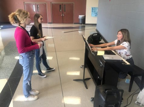 Choir members practice in the hallway outside the choir room to prepare for All Region tryouts.