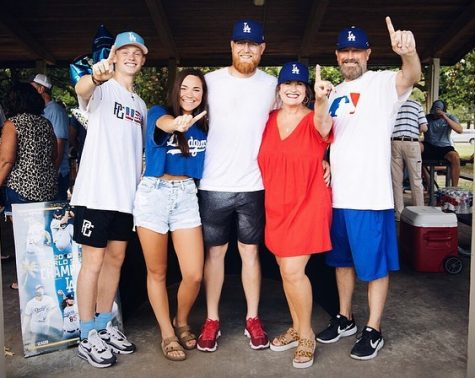 Former Wildcat Adam Scoggins celebrates with his family, the signing of a free agent deal with the Los Angeles Dodgers.